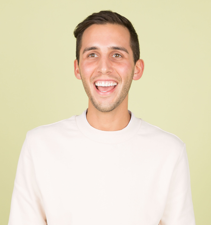 Young man enthusiastically smiling